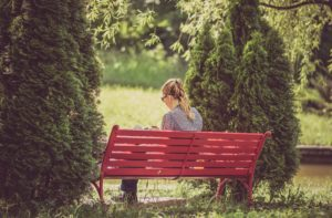 woman on bench from unsplash dot com